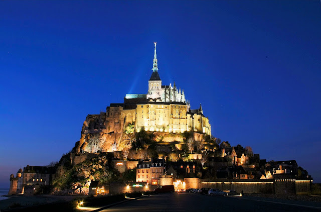 Welcome to our tour of Normandy, France. Mont Saint-Michel glows like a beacon on the edge of the sea. Photo: WikiMedia.org.