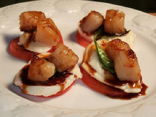 These are scallops with balsamic dressing and caprese salad