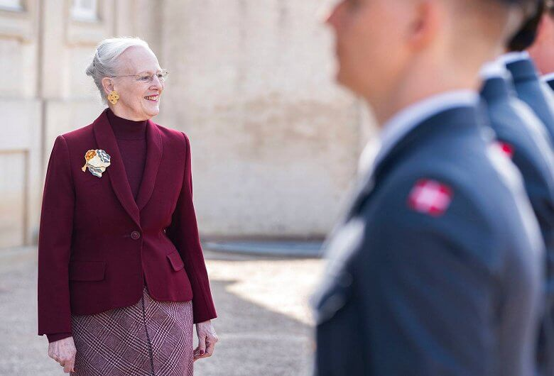 During the three receptions in the garden, Queen Margrethe of Denmark wore a red jacket and beige dress