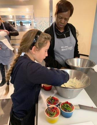 Girl preparing a dish at The Good Food Studio