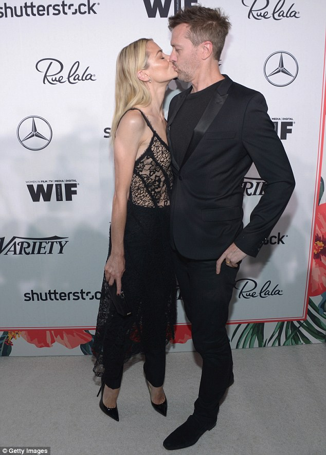 Jaime sweetly planted a kiss on her filmmaker husband Kyle Newman