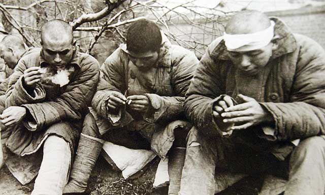 Japanese POWs, 29 January 1942 worldwartwo.filminspector.com
