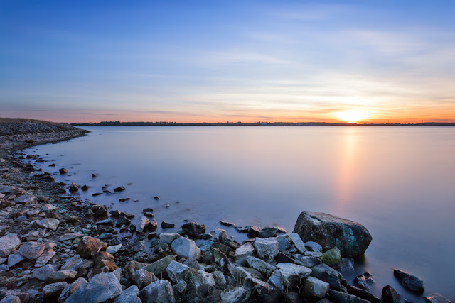 Golden sunlight hits the water at Grafham Water in Cambridgeshire