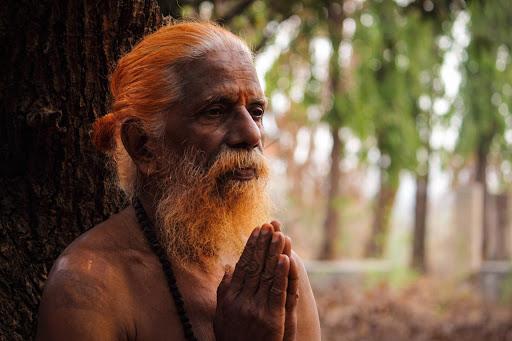Yoga of renunciation through action