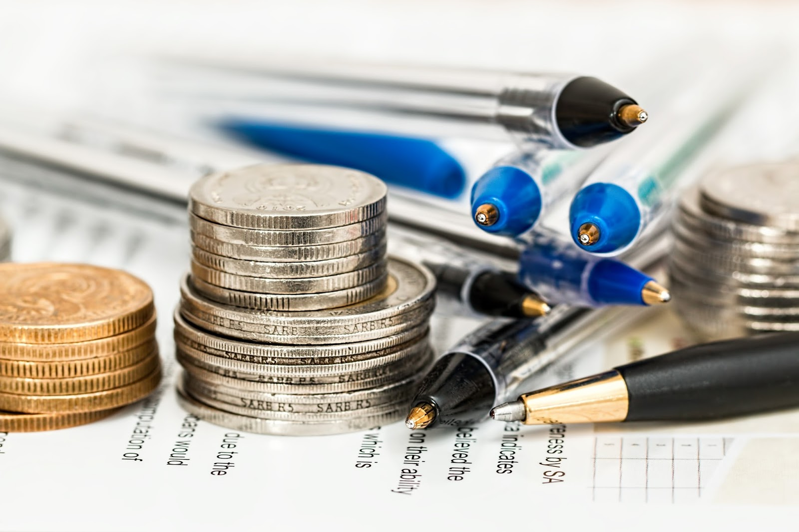 Financial Planning - pile of pens and coins