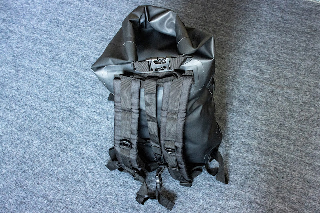 backpack straps and top closing mechanism of waterproof backpack visible
