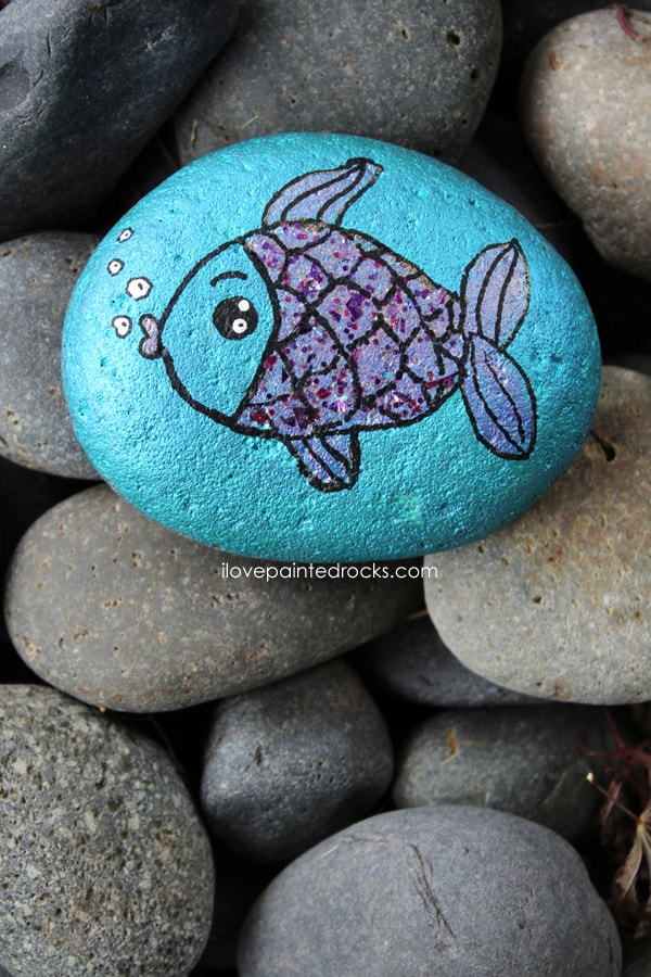 Fish painted rock with glitter scales