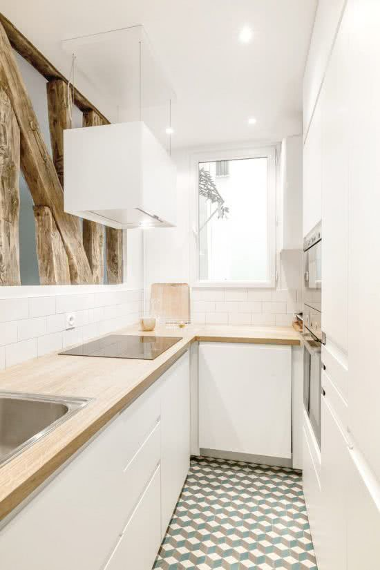 Small Scandinavian kitchen with wood.