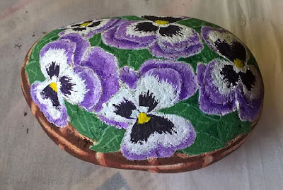 Painted Rock of Pansies in a Basket by Cindy Thomas