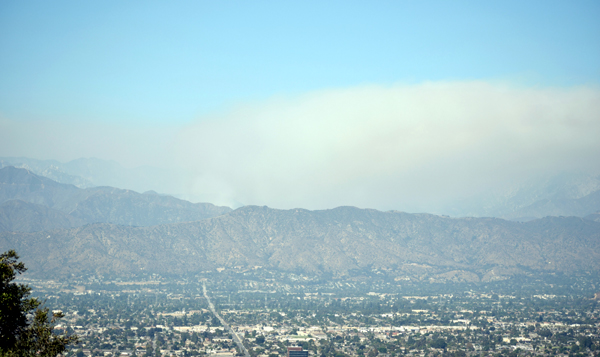 The giant smoke cloud caused by the Bobcat Fire begins to dissipate over the San Gabriel Mountains...as seen from the city of Walnut in California on September 19, 2020.