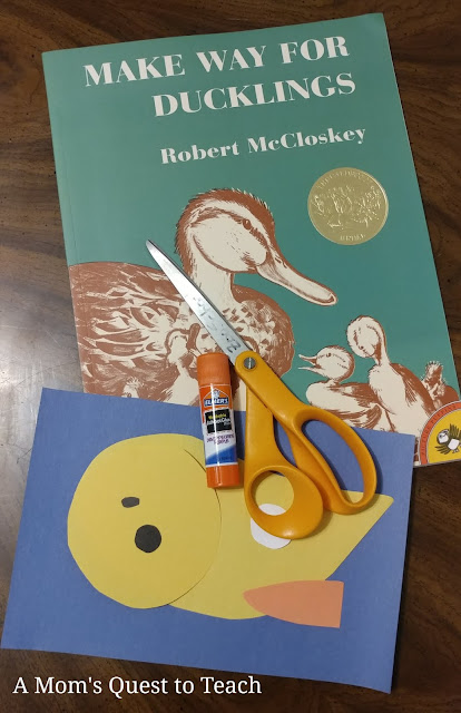materials for craft - scissors, construction paper & book Make Way for Ducklings