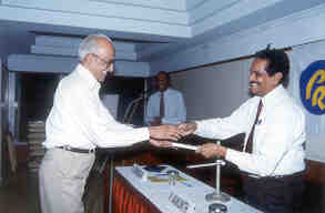 Major General Balasubramanian, Founder of Computer Society of India and a leading personality of the City presenting memento to Mr V Vaikunth, panelist