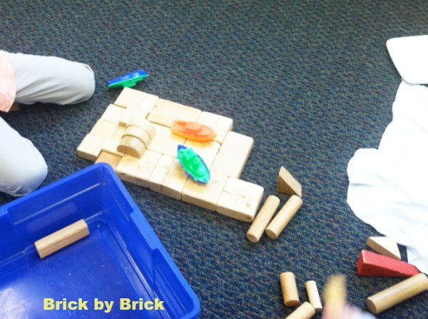 wooden blocks and boats (Brick by Brick)
