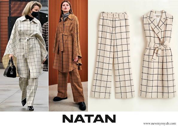 Queen Mathilde wore Natan check wool canvas cape an trousers