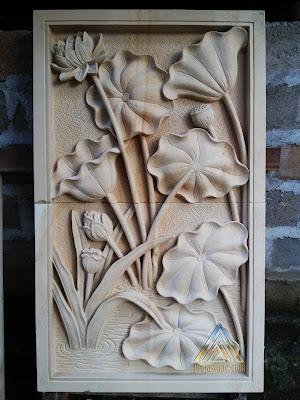 Relief batu alam paras jogja atau paras putih motif bunga lotus