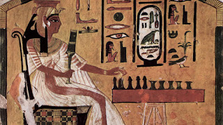 A wall painting from the 3300-year-old tomb of Queen Nefertari shows her playing senet against an invisible opponent.
