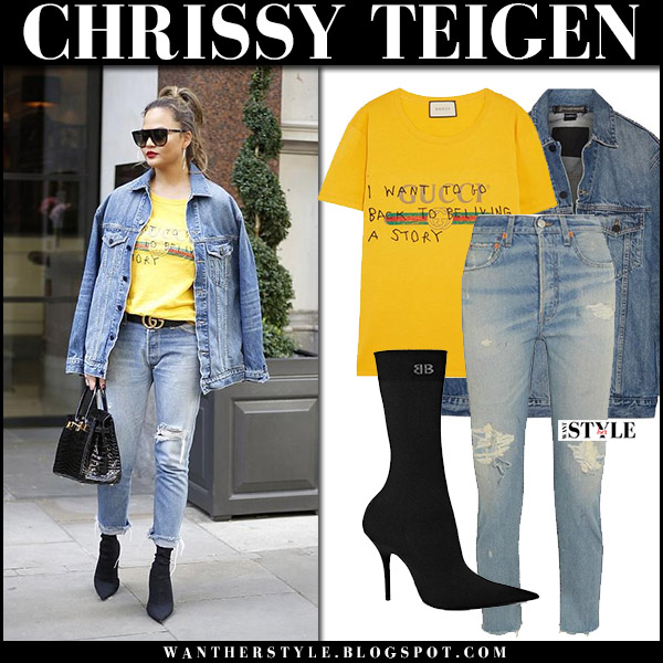 Chrissy Teigen in denim jacket, yellow gucci top, distressed jeans and black boots balenciaga september 14 2017 street fashion