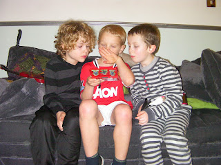 3 boys on a sofa