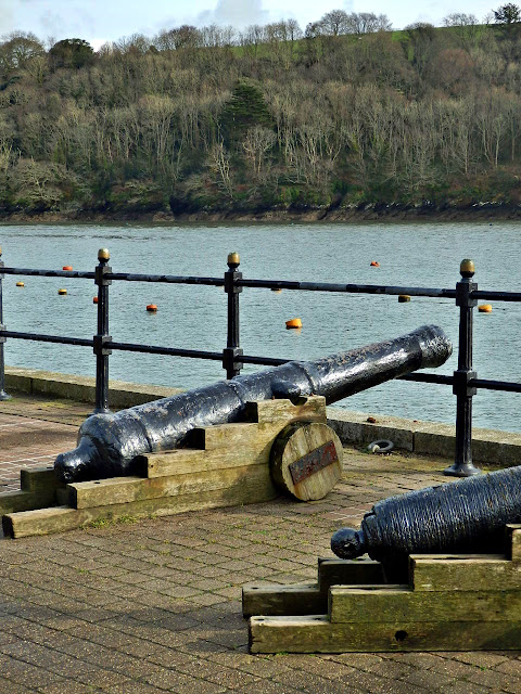 Cannons on quayside, Fowey, Cornwall.