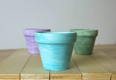 Small painted pots ready for spring decor
