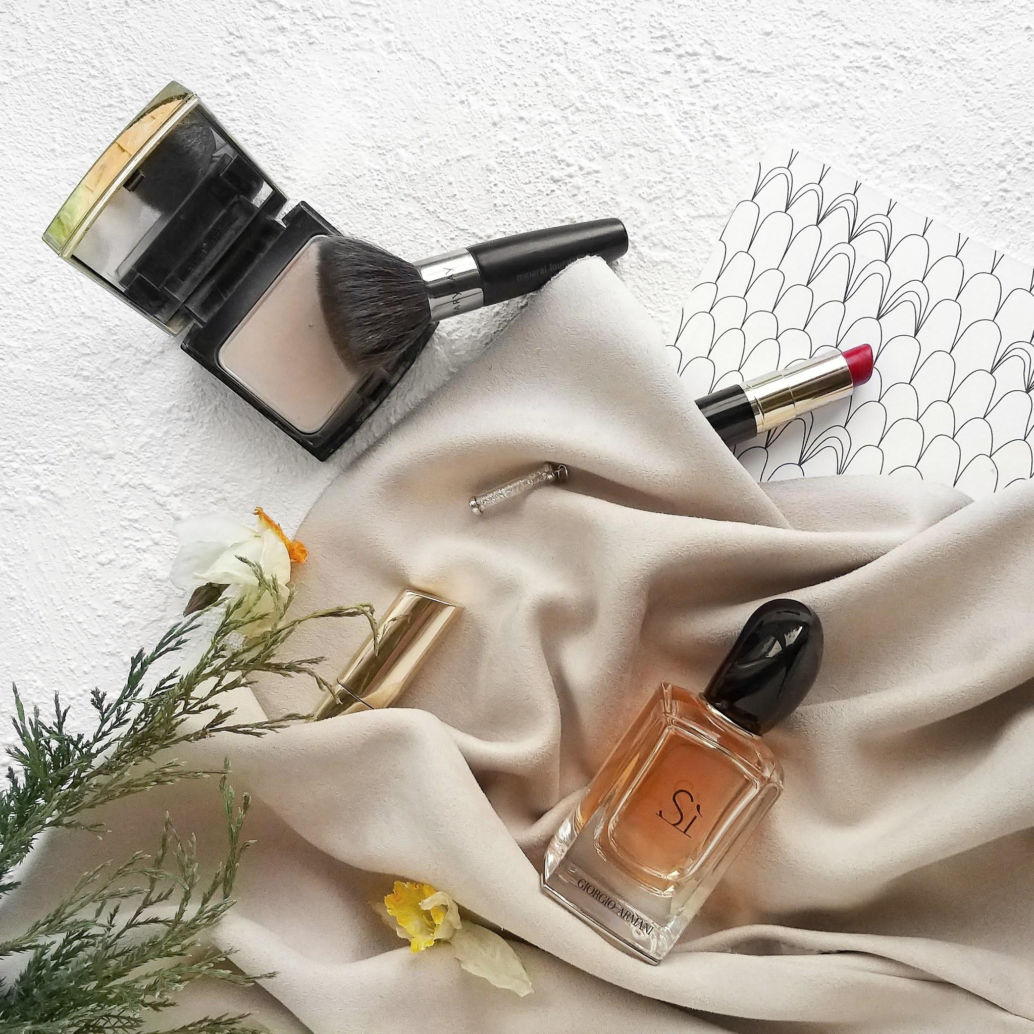 beauty products on floor, perfume, mirror, lipstick