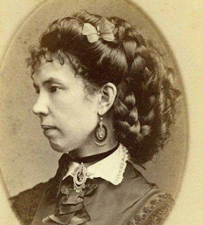 Kristin Holt | Sources of Victorian-era FALSE HAIR. Vintage Photograph of Victorian woman with thick, braided hairstyle pinned up. Courtesy of Pinterest.