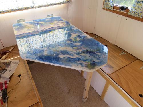 resin acrylic pour tabletop in a fiberglass trailer