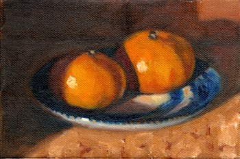 Oil painting of two mandarines on a willow pattern saucer.