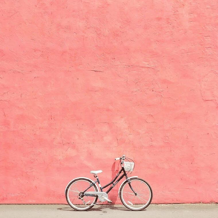Retro bike against pink wall - cardboardcities