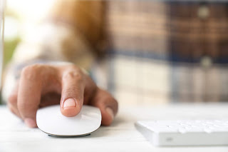 Hand clicking mouse