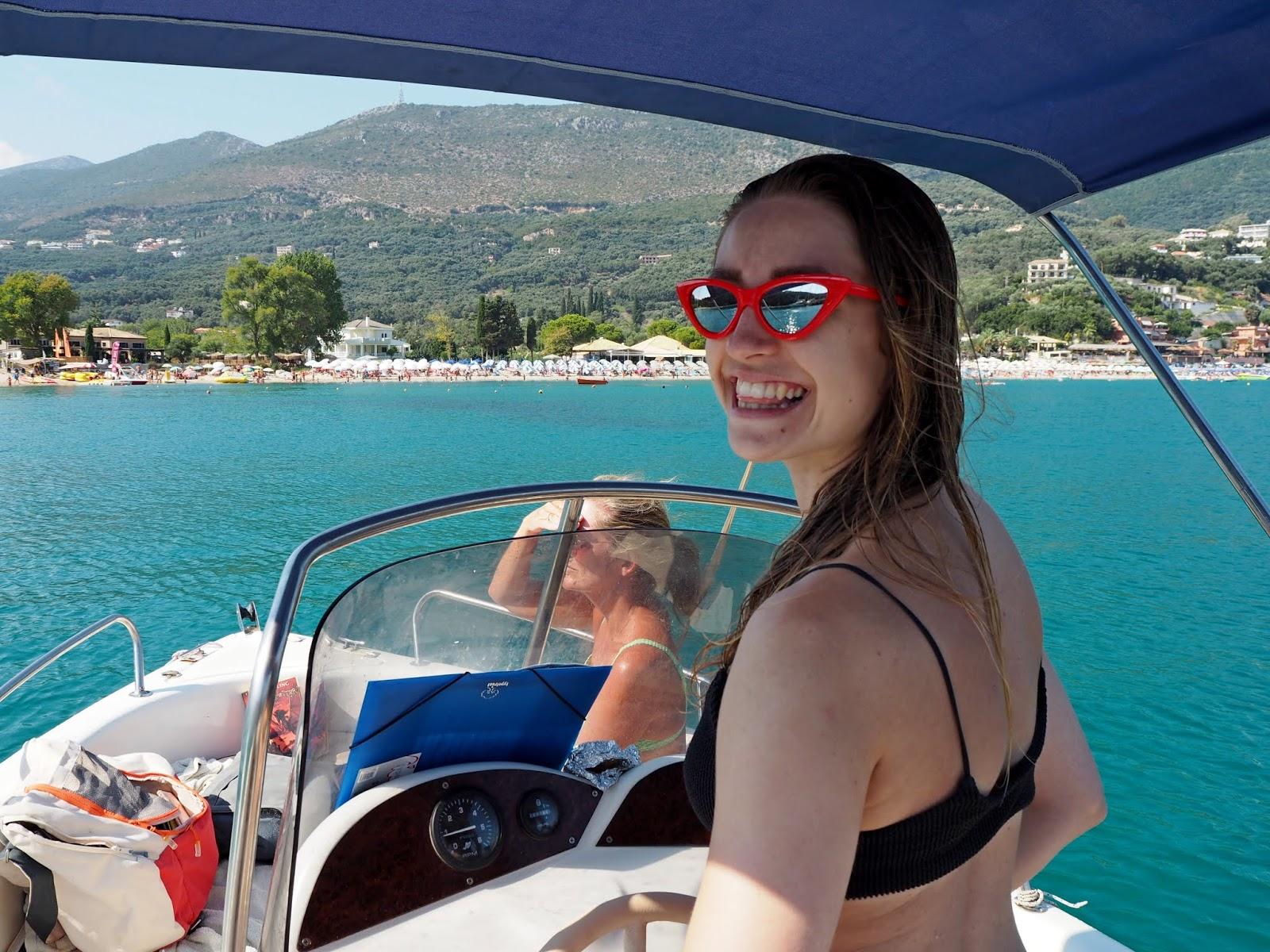 Girl driving boat