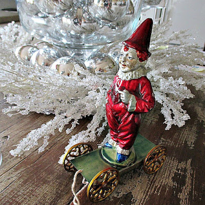 https://www.etsy.com/listing/259427046/gorgeous-vintage-christmas-pull-toy-by-r?ref=shop_home_active_80