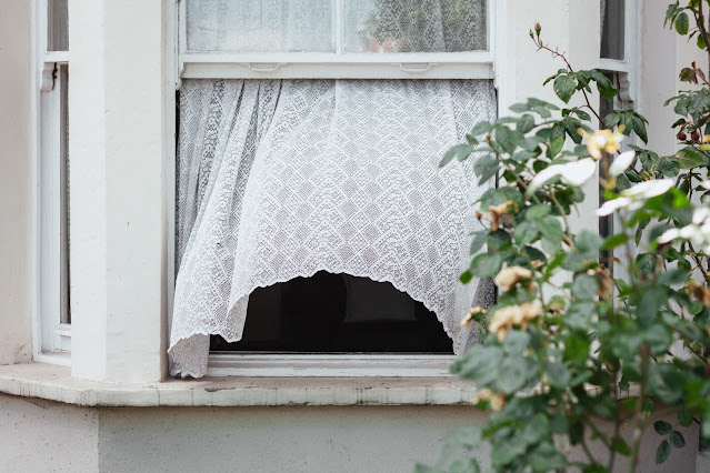 curtains blowing in window