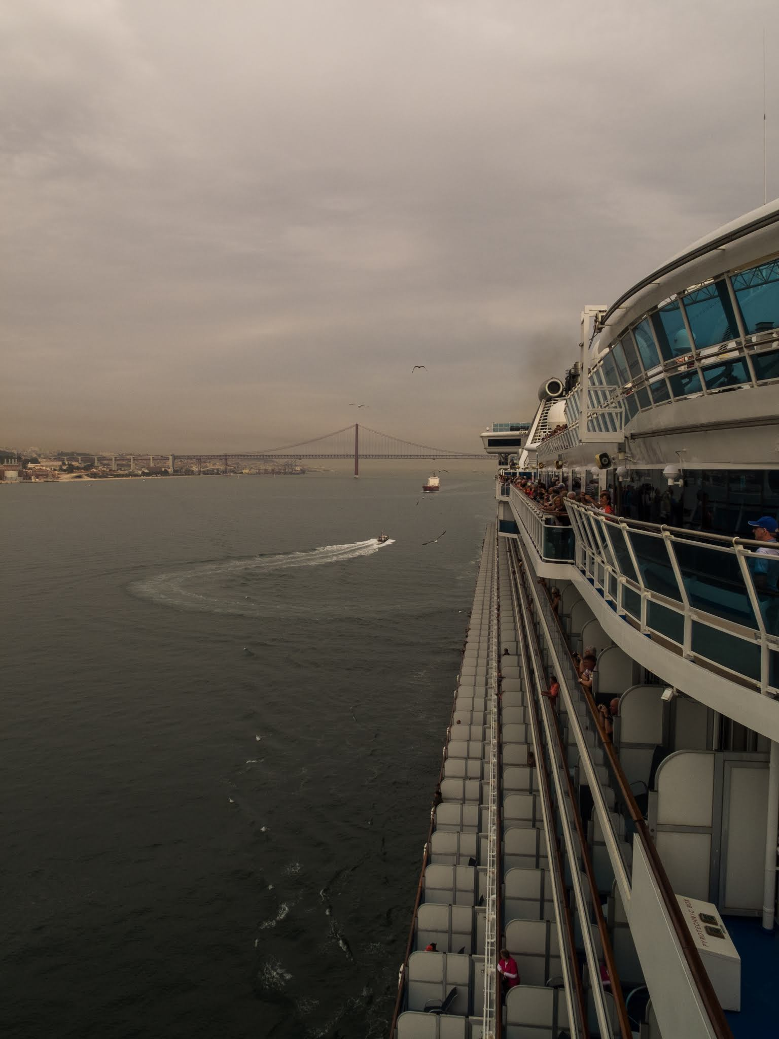 View of a cruise ship sailing from the port of Lisbon.