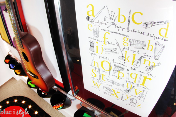 I love the music alphabet poster on rock & roll gallery wall in this playroom.