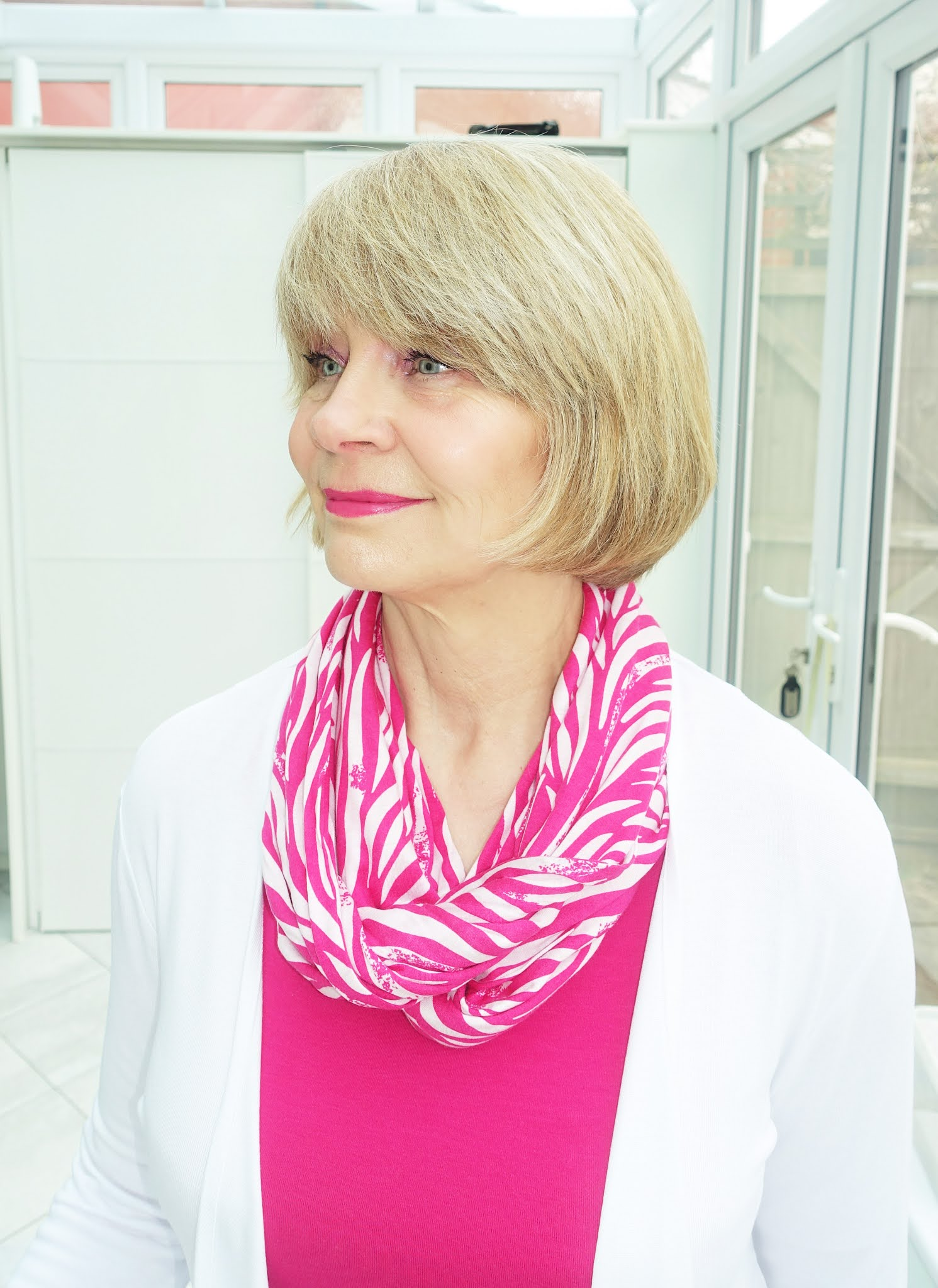 Over 50s blogger Gail Hanlon in bright pink and white