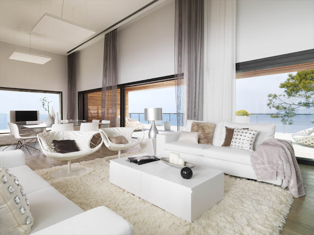 Open living room with large windows and white furniture and carpet