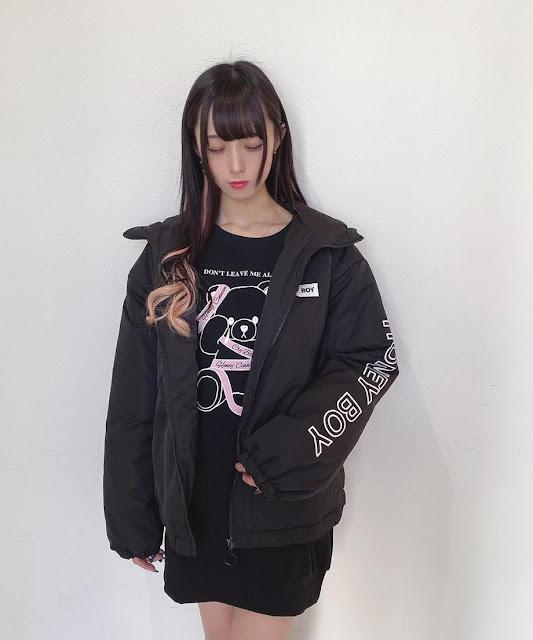 woman wearing a black honey cinnamon jacket