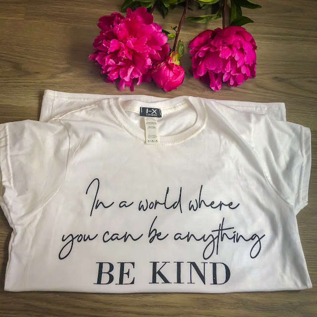 Comfy casual with Femme Luxe / flat lay with Be Kind t-shirt and pink peonies