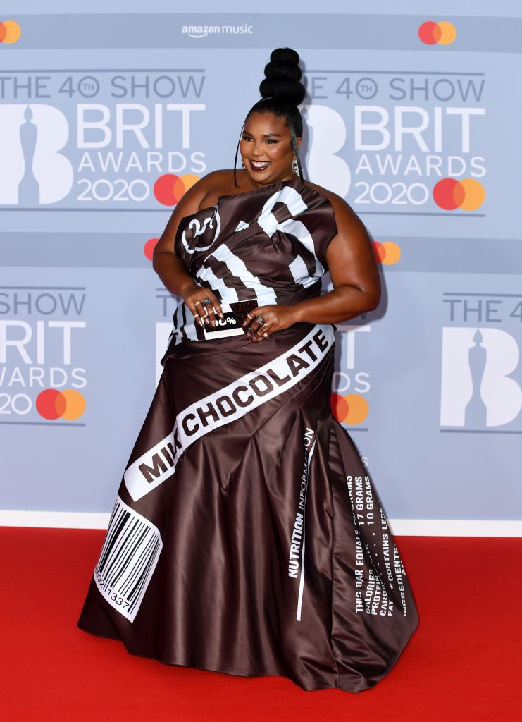 Lizzo is a sight to behold as she shows off her quirky sense of style in Hershey's chocolate bar dress