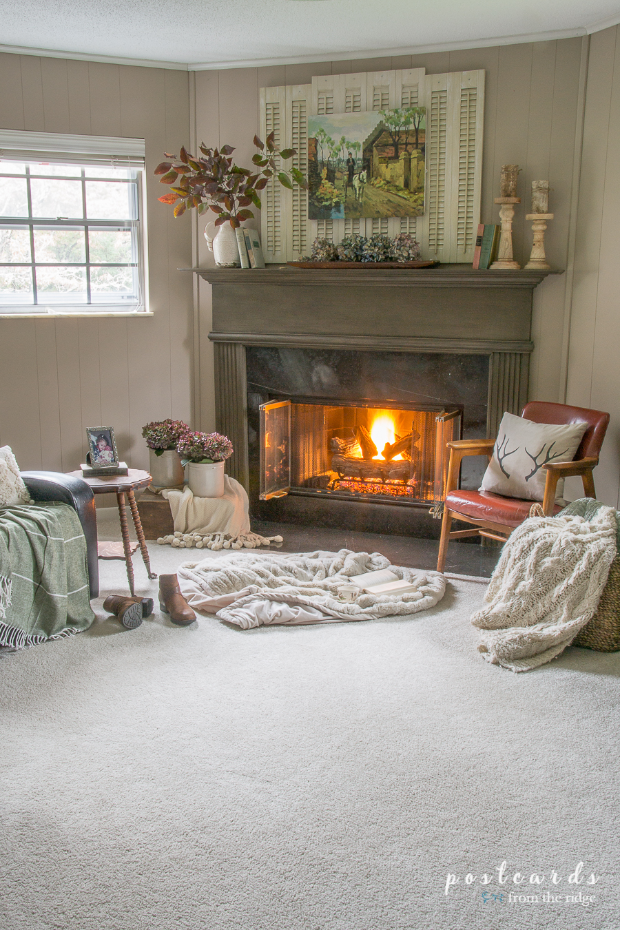 cozy room with fireplace and carpet