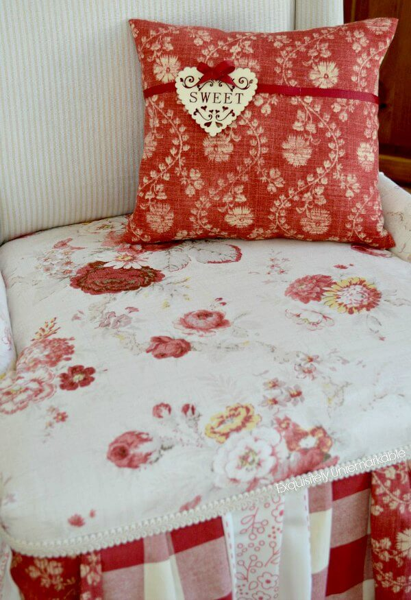 Sweet wooden tag pillow on red floral patchwork chair