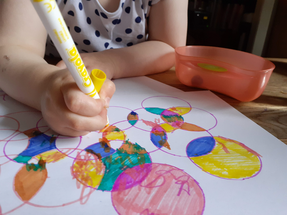 Toddler hand colouring in circles