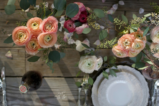 Ranunculus on weathered table dinner party