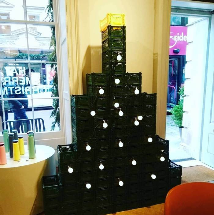 Green plastic boxes lined up in an elegant spruce