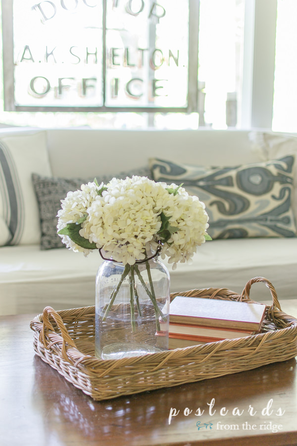 vintage mason jar with white hydrangeas n wicker  tray