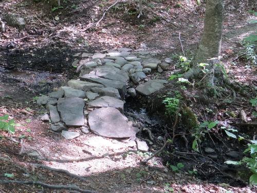 stone work on wet trail