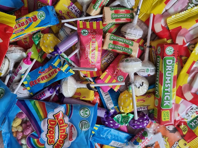 A mixture of Swizzel Sweets including refreshers, love hearts, fizzers and rainbow drops