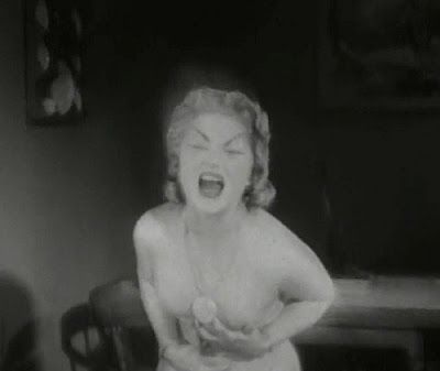 Still - Shirley Kilpatrick at the climax of The Astounding She-Monster (1957)