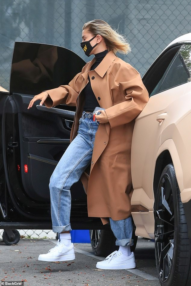Hailey Bieber Wearing a brown trench coat